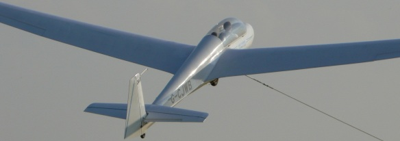 A glider being winch launched.