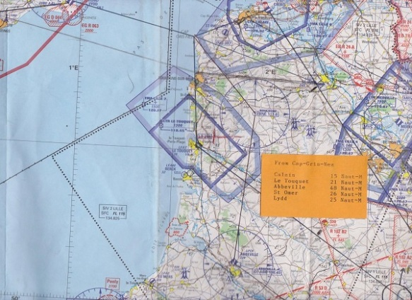 Aeronautical map of northern france with a rout plotted on it.