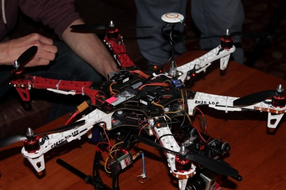 A hexacopter sitting on a bar table.