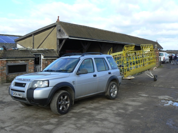 Landrover Freelander with aircraft on tow hook.