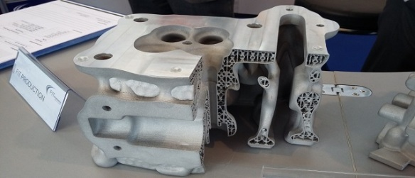 Rapid prototyping of a cylinder head giving approx.9 times the cooling area and 60% weight saving compared with the conventional cast head below