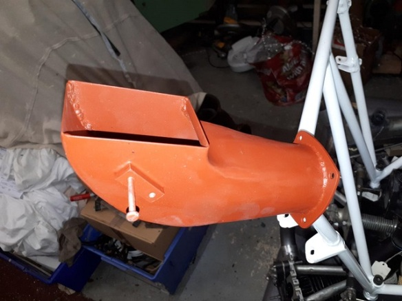 Engine inlet duct painted in orange primer.