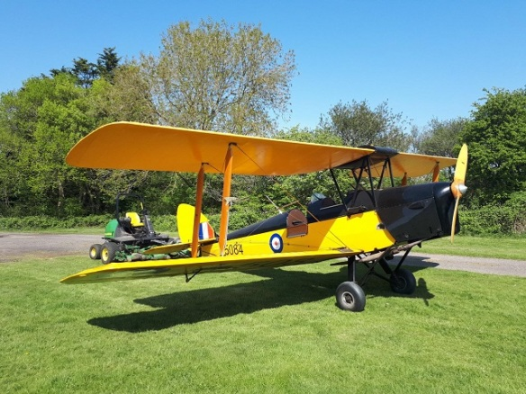 Tiger Moth attached to a small towing tractor.