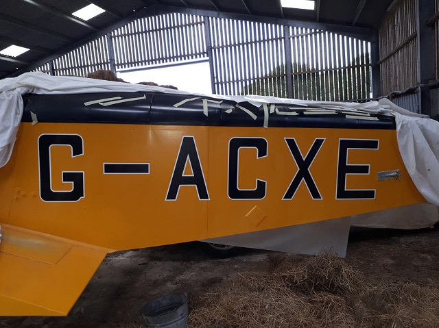 The registration letters freshly applied to the side of an aircraft.