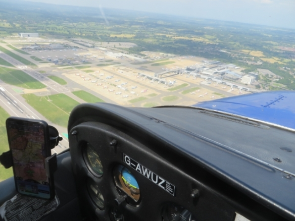 A view of Gatwick Airport from low level from the windscreen of a light aircraft.